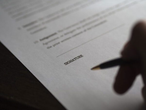 this is a photo of a signing of a Trust Document